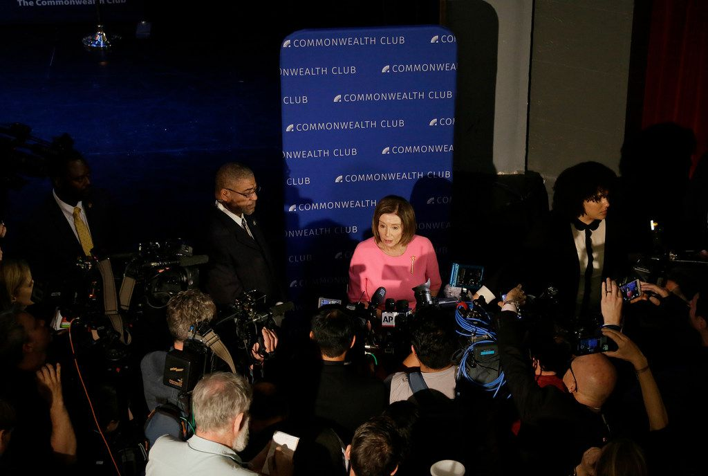 Speaker of the House Nancy Pelosi, D-Calif., is surrounded by reporters after speaking to the Commonwealth Club on May 29 in San Francisco.
