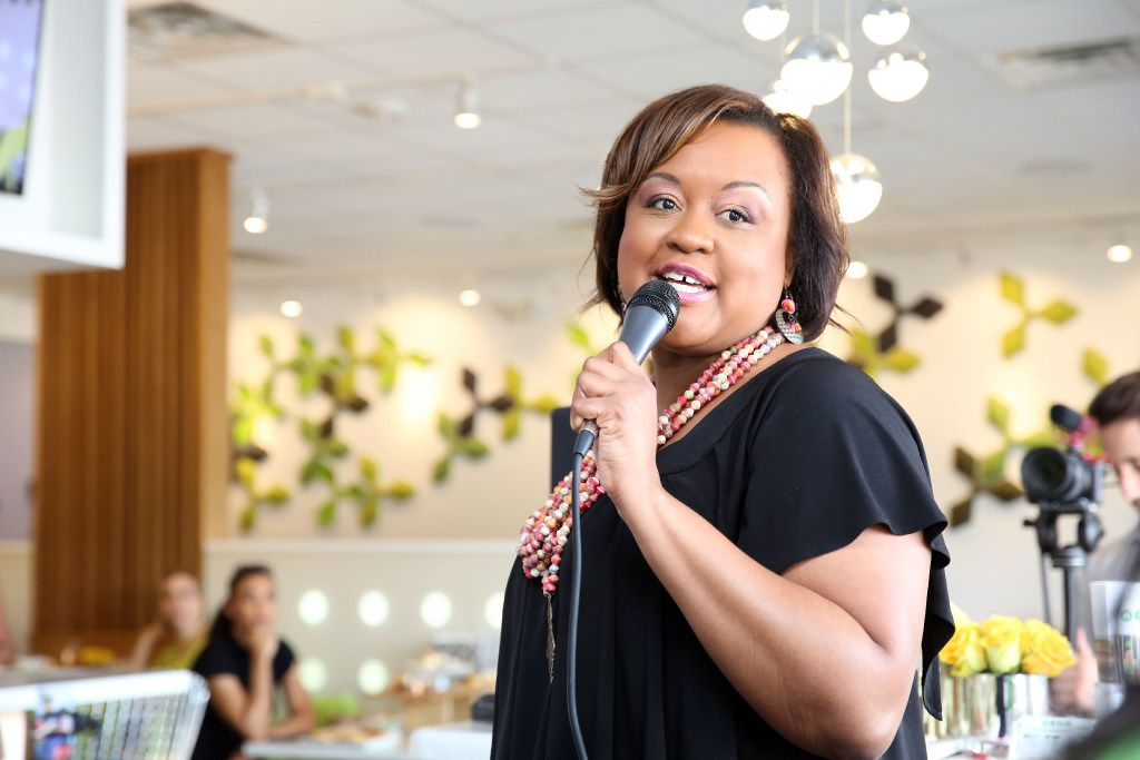 Bianca Jackson, of Genesis Women's Shelter, speaks at the fashion show event at Asian Mint in Dallas on June 4.