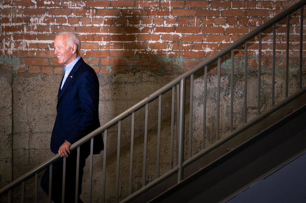 Democratic presidential candidate Joe Biden walks down a staircase as he is introduced before speaking to participants in the Dallas Mayor's Intern Fellows Program during a campaign event at SPARK! on Wednesday, May 29, 2019, in Dallas.
