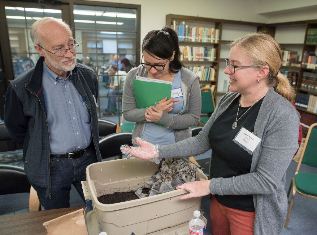 Greg Browder and Sayo Gonzalez (center) listened to Jessica Rinaldi talk about vermicomposting (composting with worms) during the Seeding Dallas: Good Food for the City event held last month at Cliff Temple Baptist Church.