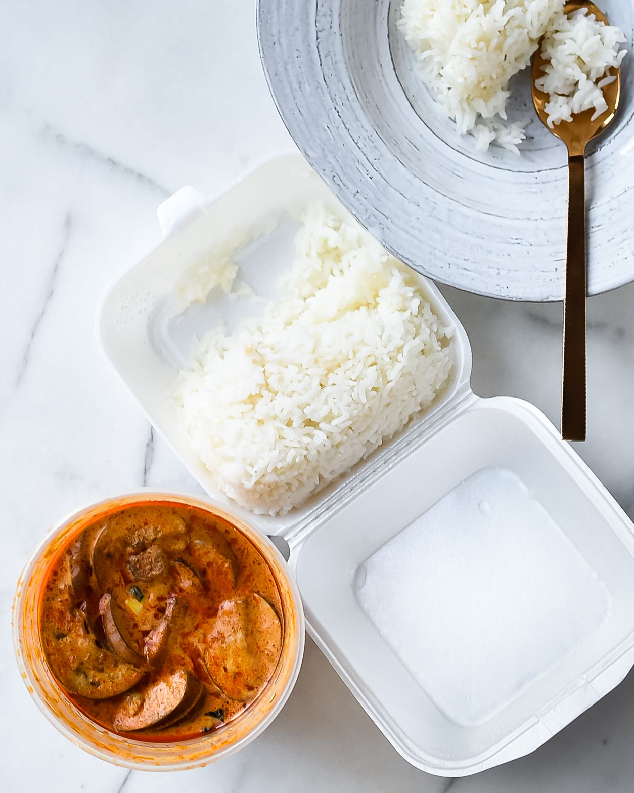 Classic white rice can be served with red chicken curry.