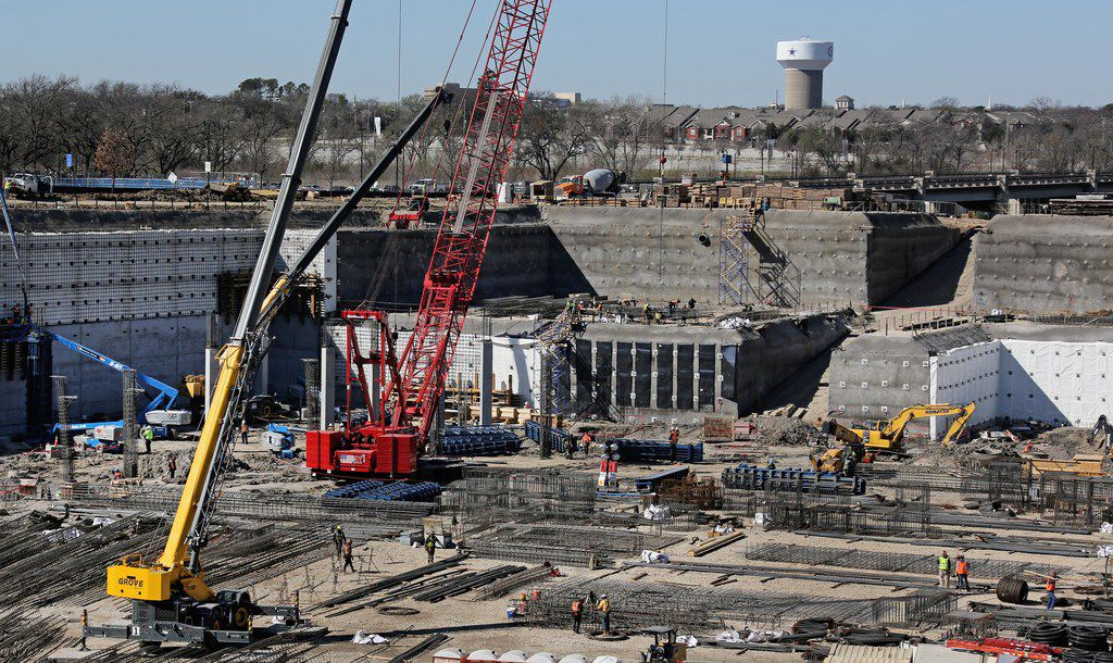 Home plate will sit approximately where the red crane is as construction continues on the new Texas Rangers baseball stadium in Arlington.