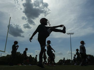 Garland Naaman Forest freshman football players practice at the school on Friday, Aug. 9, 2019, in Garland, Texas.  The teamÕs coaches delayed practice Friday by an hour an a half due to the heat index earlier in the afternoon.