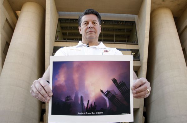 Dallas Fire-Rescue Deputy Chief Daniel DeYear holds a photograph of Ground Zero just days after Sept. 11, 2001. The native New Yorker attended 30 to 40 funerals for rescue personnel who died when the World Trade Center collapsed.
