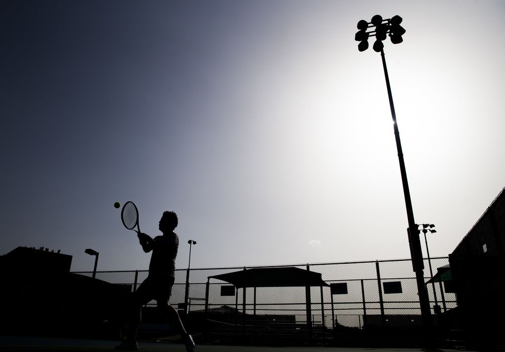 Antonio Sosa works on his backhand during a tennis lesson in 104 degree heat on Tuesday, July 17, 2018 at Plano West Senior High School in Plano, Texas.