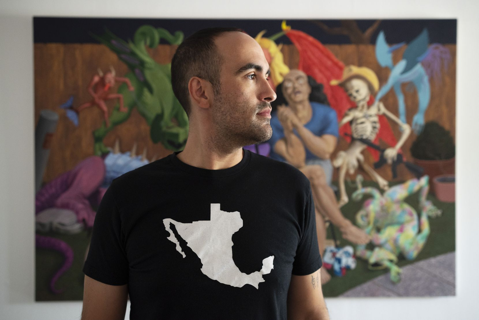"""Artist Francisco Moreno with one of his pieces of art work titled """"The Allegory of Weed Gummy and Alcohol Induced Anxiety,"""" on display at the Oliver Francis Gallery in Dallas."""