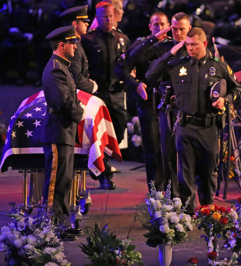Dallas officers pay their final respects to slain colleague Rogelio Santander at the funeral service at Lake Pointe Church in Rockwall.