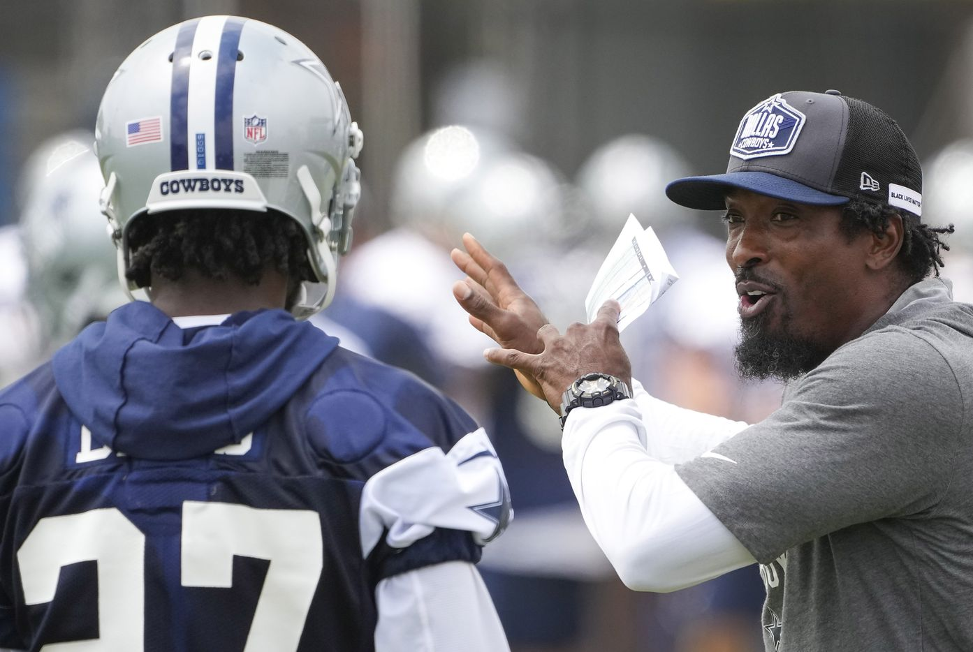 Dallas Cowboys defensive backs coach Al Harris works with cornerback Trevon Diggs (27) during a practice at training camp on Sunday, July 25, 2021, in Oxnard, Calif.