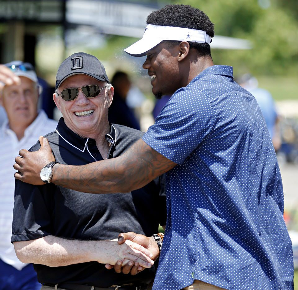 Dallas Cowboys owner Jerry Jones talks with defensive end Randy Gregory during the team's annual charity golf tournament