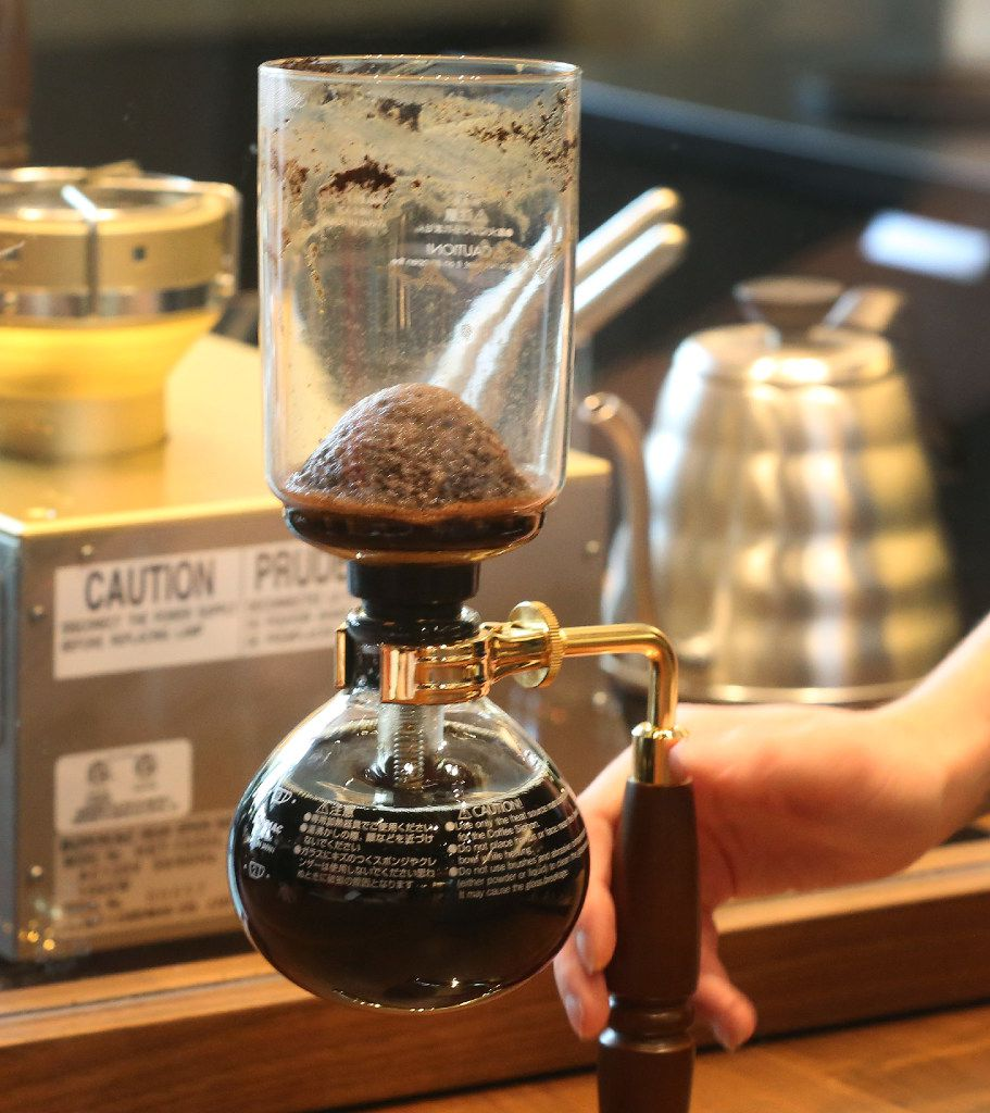 The siphoning process is one of Starbucks Reserve Bars' most complex. Here, the dome shape of the coffee grounds, with the brewed coffee in the chamber below, show it was made correctly.