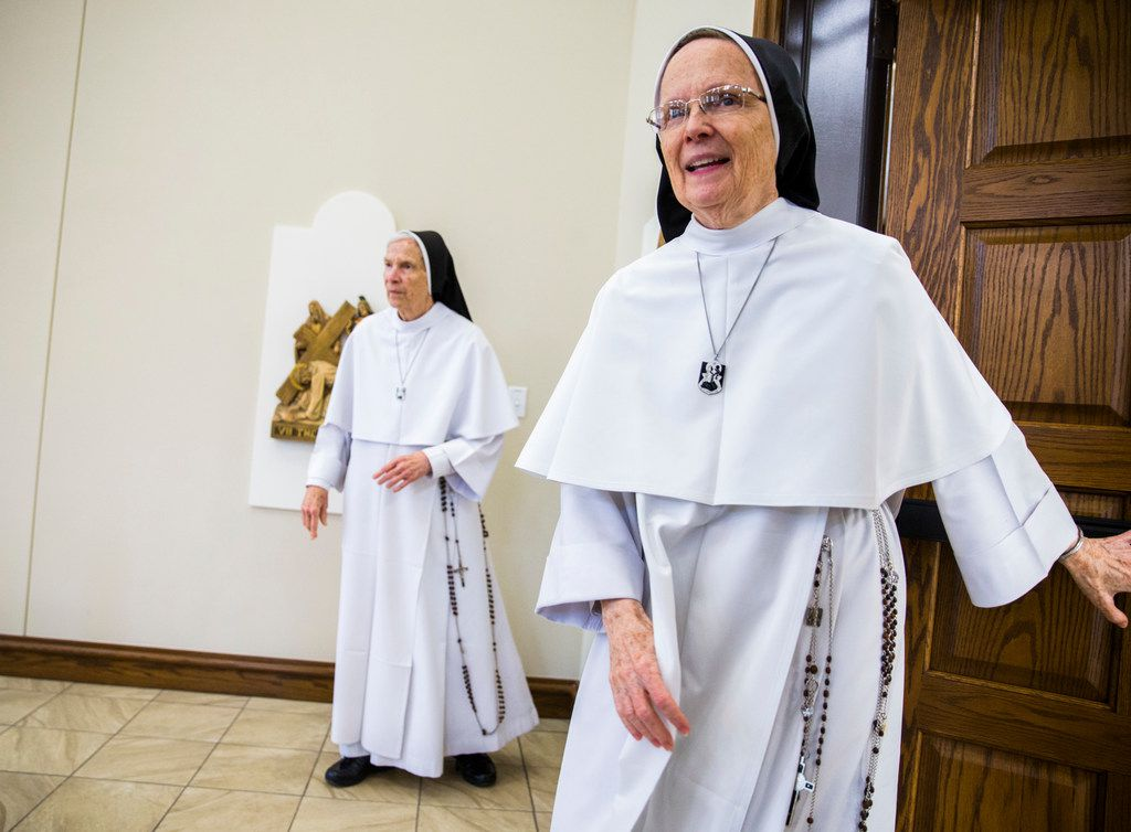 Sister Joseph Andrew Bogdanowicz (right) and Mother Assumpta Long, both foundresses of the Dominican Sisters of Mary, Mother of the Eucharist, walk into a temporary chapel inside a new convent in Georgetown, Texas, on Feb. 18, 2019. Both women live in Ann Arbor, Mich., but traveled to Texas to speak to the media at the new convent location.