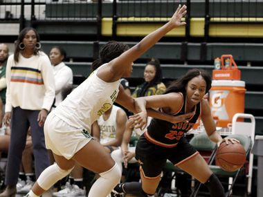 South Grand Prairie's Madyson Jean-Louis (right) drives against the aggressive defense of DeSoto's Ash'a Thompson during DeSoto's 51-34 win Tuesday. (Steve Hamm/Special Contributor)