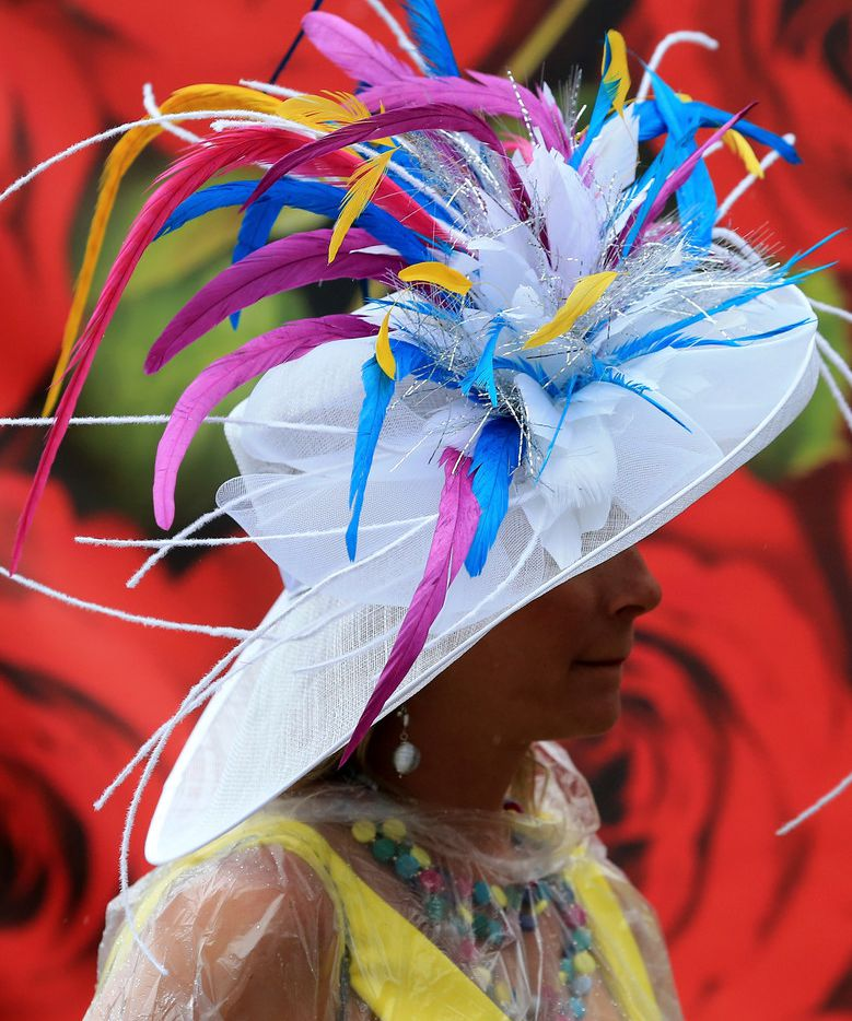 A woman wearing a festive hat, a Kentucky Derby day tradition.