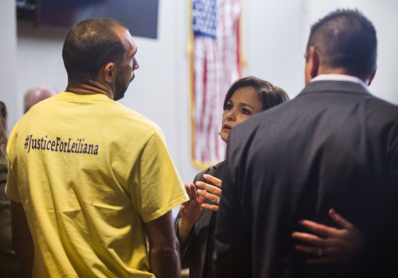 Brian Maker, father of Liliana Wright, talks with prosecutor Eren Price at the Frank Crowley Courts Building in Dallas.