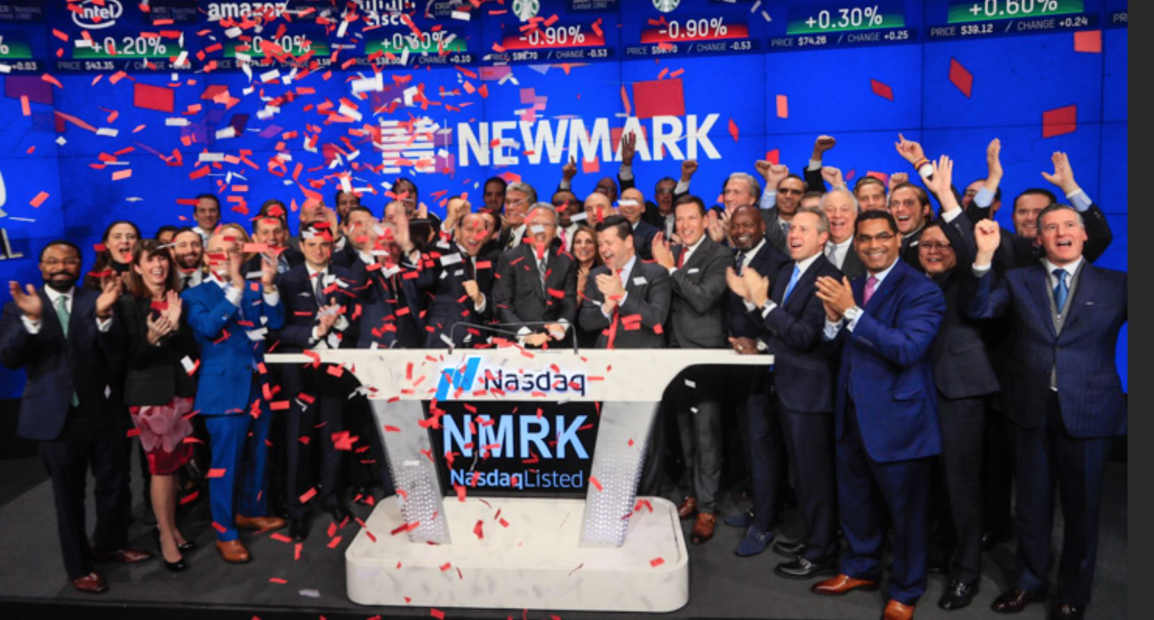 Emmitt Smith (front row, third from right) was on hand in New York last month when Newmark Group had its first public stock offering.