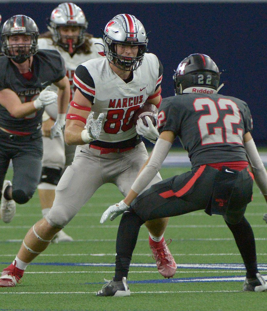 Flower Mound Marcus' Collin Sutherland (80) looks for running room as Lake Highlands Andrew Morgan closes in for the tackle in the first half of a Class 6A Division II area round high school playoff football game between Flower Mound Marcus and Lake Highlands, Saturday, Nov. 23, 2019, in Frisco, Texas. (Matt Strasen/Special Contributor)