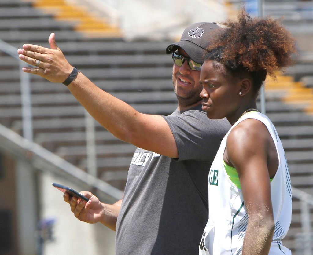 Mansfield Lake Ridge track coach James Whisenhunt speaks with Jasmine Moore following one of her competition jumps in the triple jump event.  Moore is one of the top student athletes in the nation in the event. The Class 6A Region l and 5A Region ll track and field meet was held at UT-Arlington's Maverick Stadium in Arlington on April 28, 2018. (Steve Hamm/ Special Contributor)  (NOTE: SPORTS requested this image for consideration to accompany a future feature to spotlight Moore.)
