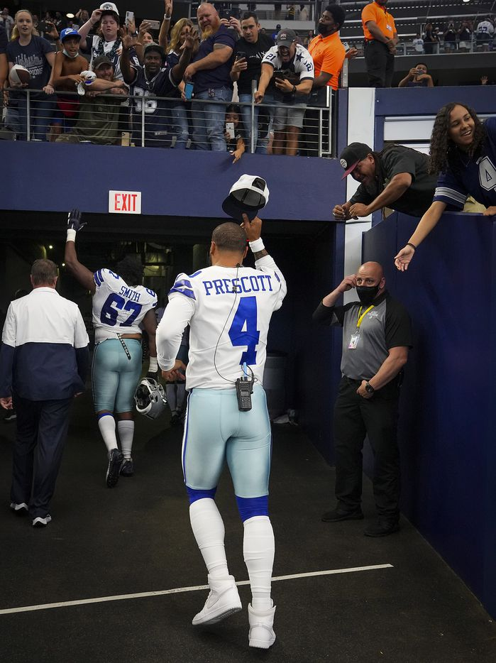 Dallas Cowboys quarterback Dak Prescott tosses his cap to the crowd as he leaves the field following a loss to the Jacksonville Jaguars in a preseason NFL football game at AT&T Stadium on Sunday, Aug. 29, 2021, in Arlington. (Smiley N. Pool/The Dallas Morning News)
