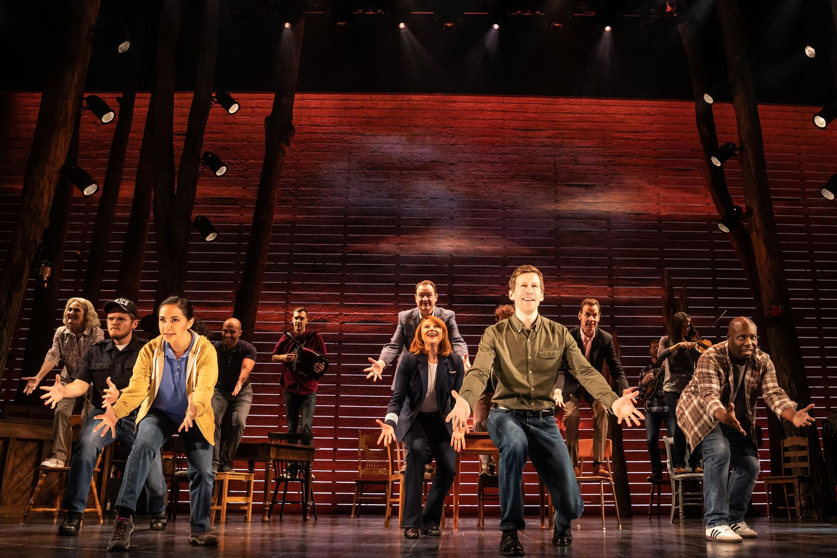 "Julie Johnson (far left) and Chamblee Ferguson (third from right) are part of the North American touring cast of the hit Broadway musical ""Come From Away."""