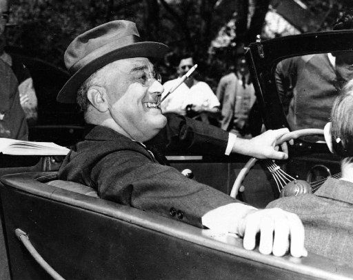President Franklin Delano  Roosevelt sits at the steering wheel of his automobile at Warm  Springs, Ga., on April 4, 1939.