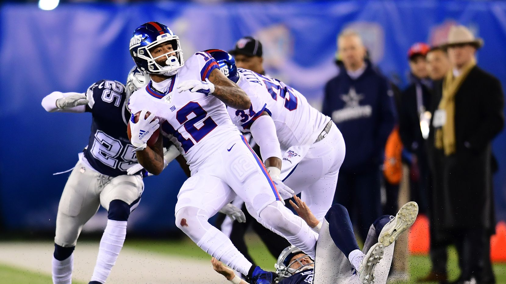 EAST RUTHERFORD, NEW JERSEY - NOVEMBER 04: Cody Latimer #12 of the New York Giants is tackled by Brett Maher #2 and Xavier Woods #25 of the Dallas Cowboys in the second half of their game at MetLife Stadium on November 04, 2019 in East Rutherford, New Jersey. (Photo by Emilee Chinn/Getty Images)