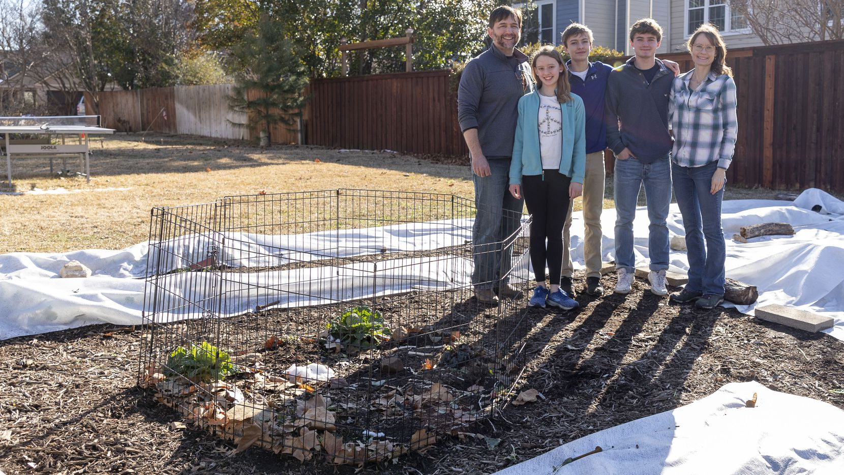 """The neighbors in the Marshes' Grapevine neighborhood have been supportive of the family's garden. """"The neighbors seem to get a kick out of it,"""" says Eric Marsh. """"It's a great conversation piece."""" Pictured are Eric (from left), Casey, Mason, Deric and Betsy Marsh."""
