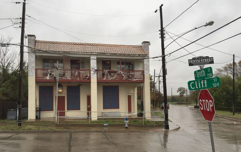 An old two-store building at the corner of East Tenth and Cliff streets. in Dallas was once a corner store. Is it one of the few in the area that is occupied and being rehabbed. Photographed Wednesday Nov. 8, 2017.