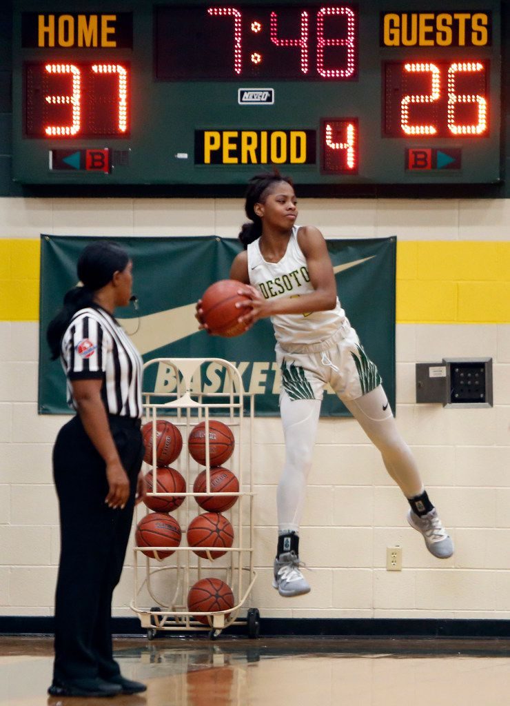 DeSoto's Ja'Mia Harris (4) leaps to keep the ball in bounds during 4th quarter action against South Grand Prairie. The two teams played their District 7-6A girls basketball game at DeSoto High School in DeSoto on January 21, 2020. (Steve Hamm/ Special Contributor)