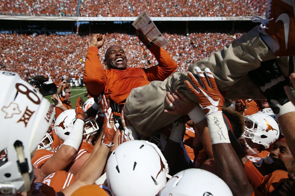 Texas Longhorns head coach Charlie Strong is lifted by his players after beating the Oklahoma Sooners after an NCAA football game between Oklahoma and Texas at the Cotton Bowl in Dallas Saturday October 10, 2015. Texas Longhorns beat Oklahoma Sooners 24-17. (Andy Jacobsohn/The Dallas Morning News)