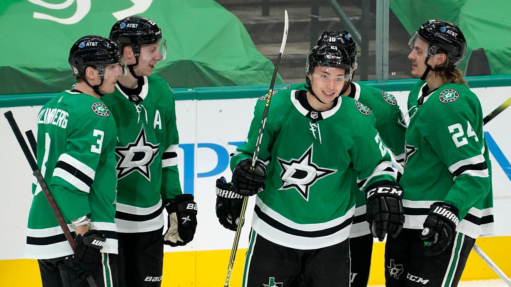 Dallas Stars' John Klingberg (3), Esa Lindell, left rear, Jason Robertson (21), Joe Pavelski, rear, and Roope Hintz (24) celebrate Robertson's unassisted goal against the Florida Panthers in the third period of an NHL hockey game in Dallas, Saturday, April 10, 2021.