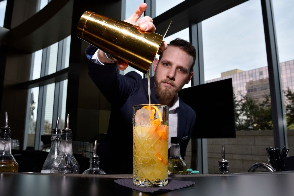 Bartender Tyler Upshaw prepares a Grove nonalcoholic cocktail with Seedlip grove at the Pegasus Bar inside the Omni Hotel in downtown Dallas.