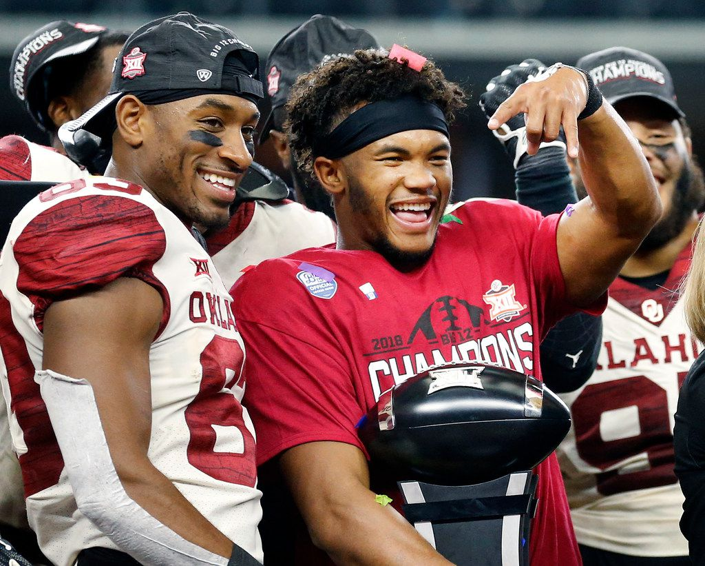 Oklahoma Sooners quarterback Kyler Murray give the horns down hand signal after receiving the MVP trophy in the Big 12 Championship at AT&T Stadium in Arlington, Texas, Saturday, December 1, 2018. The Sooners defeated the Texas Longhorns, 39-27. (Tom Fox/The Dallas Morning News)