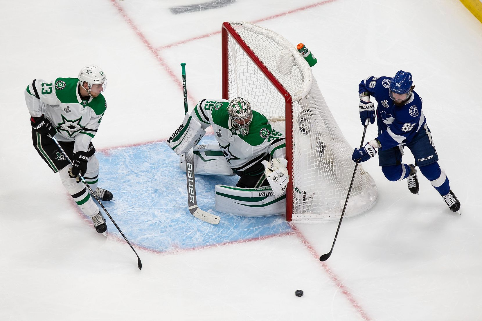 Esa Lindell (23) and goaltender Anton Khudobin (35) of the Dallas Stars defend against Nikita Kucherov (86) of the Tampa Bay Lightning during Game Two of the Stanley Cup Final at Rogers Place in Edmonton, Alberta, Canada on Monday, September 21, 2020. (Codie McLachlan/Special Contributor)