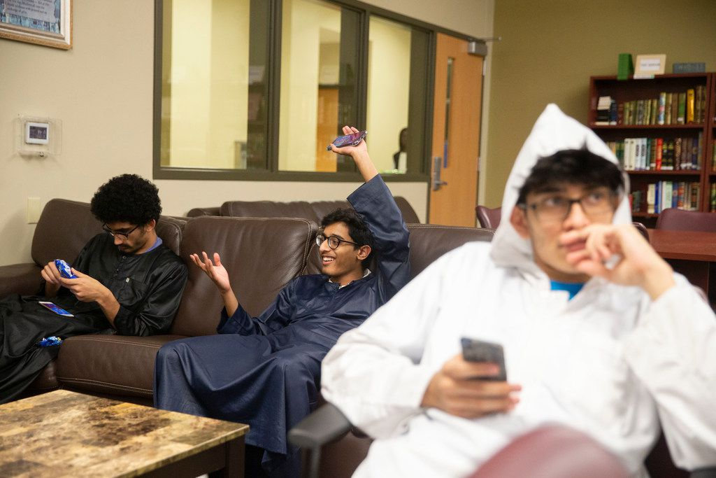 Faraj Khan Pathan chats with Raiyan Uddin, middle, as Talha Mohammed keeps an eye on the game of Ludo at Islamic Association of Collin County in Plano Texas on Sunday, June 2, 2019. (Shaban Athuman/Staff Photographer)