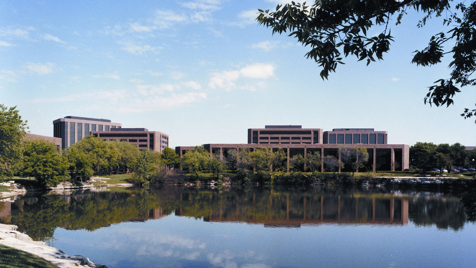 New apartments and retail would replace some of the office buildings around the lake in The Centre office park on Midway Road. (File Photo)