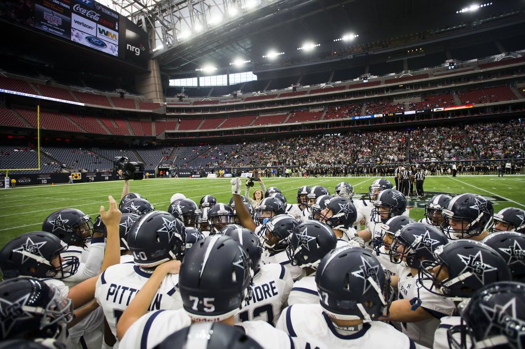 Frisco Lone Star players huddle before the Class 5A Division II state championship football game against Cedar Park at NRG Stadium on Saturday, Dec. 19, 2015, in Houston. (Smiley N. Pool/The Dallas Morning News)