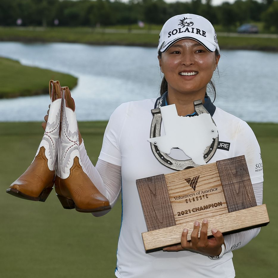 Professional golfer Jin Young Ko holds the winner's trophy and a pair of Lucchese boots after winning the LPGA VOA Classic on Sunday, July 4, 2021, in The Colony, Texas. Ko finished the tournament 16 under par. (Elias Valverde II/The Dallas Morning News)