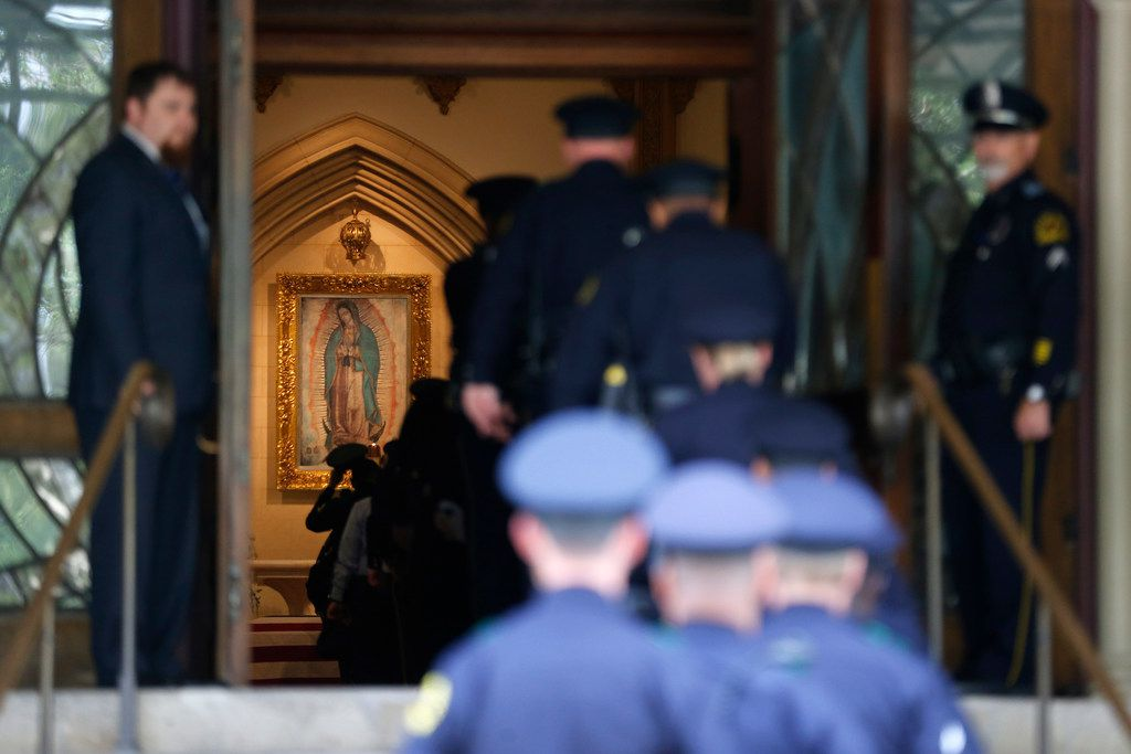 Police officers walk in the front door during a public visitation for Officer Rogelio Santander at Cathedral Shrine of the Virgin of Guadalupe in Dallas on Monday April 30, 2018. (Nathan Hunsinger/The Dallas Morning News)
