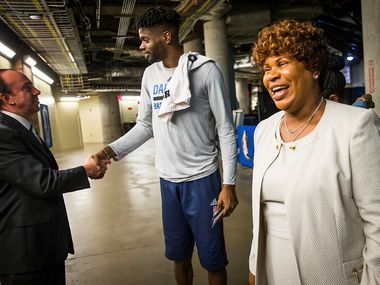 Dorcina Noel smiles as her son, Dallas Mavericks forward Nerlens Noel, chats with team COO Floyd Jahner in the tunnel before an NBA basketball game at American Airlines Center on Friday, March 10, 2017, in Dallas. (Smiley N. Pool/The Dallas Morning News)