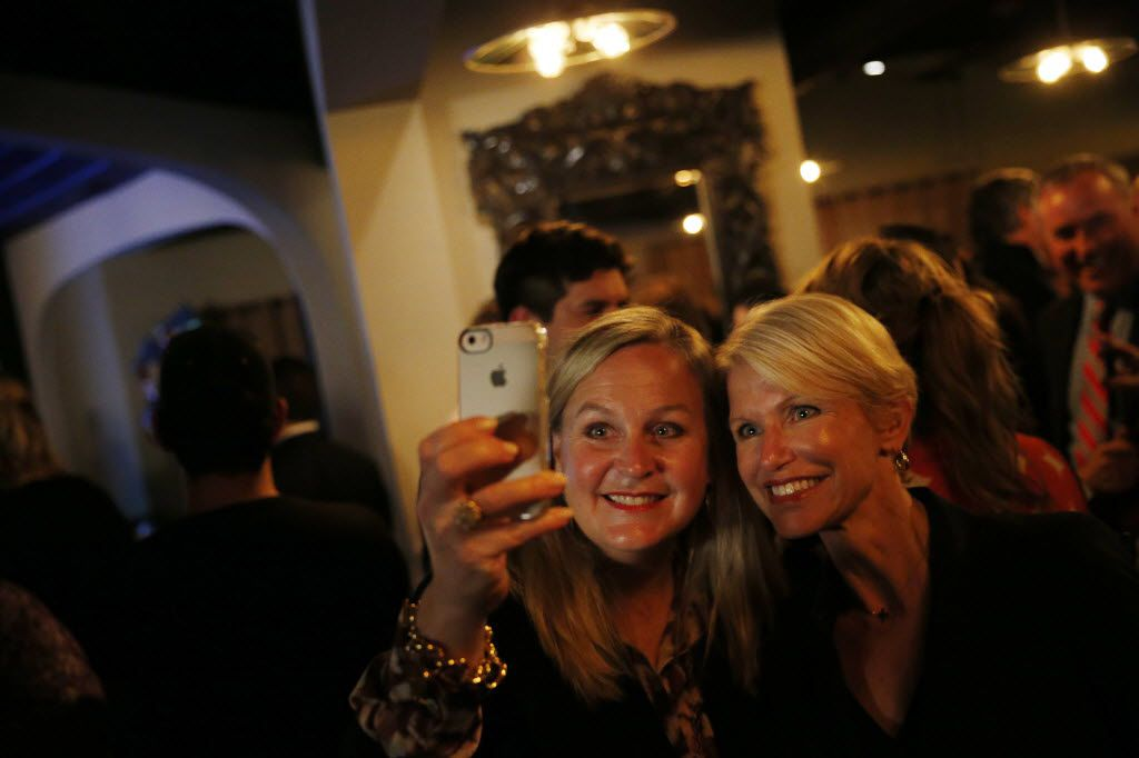 Alison McIntosh, a Republican political fundraiser, takes a selfie with Susan Hawk (right)  during an election results watch party for Hawk, the Republican candidate for Dallas County District Attorney, at Mesomaya in Dallas Tuesday November 4, 2014. (Andy Jacobsohn/The Dallas Morning News) 11062014xNEWS