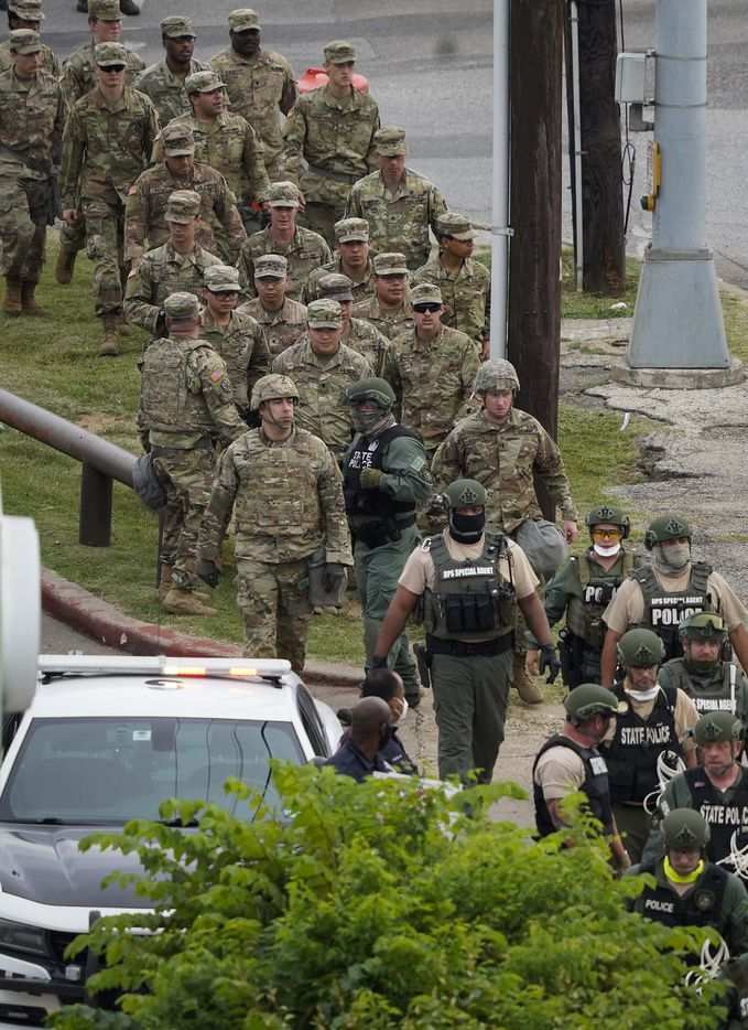 National Guard troops and DPS troopers head toward a protest rally the Frank Crowley Courts Building as protests continue after the death of George Floyd on Monday, June 1, 2020, in Dallas.