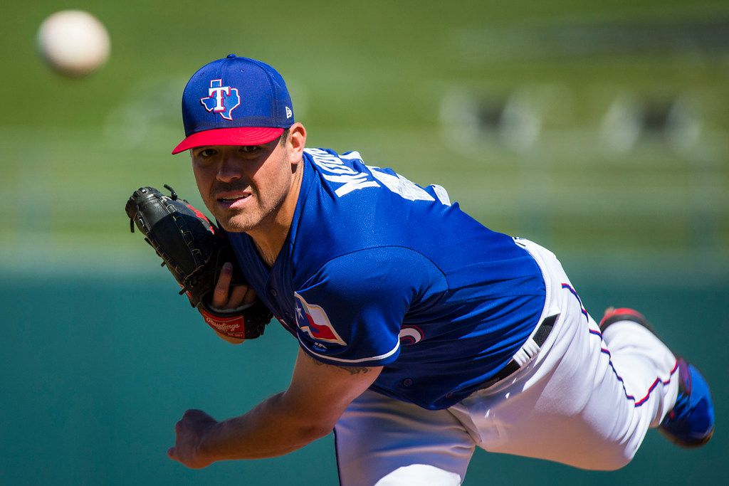 Texas Rangers pitcher Matt Moore pitches during the first inning of a spring training baseball game against the San Francisco Giants on Monday, March 5, 2018, in Surprise, Ariz. (Smiley N. Pool/The Dallas Morning News)