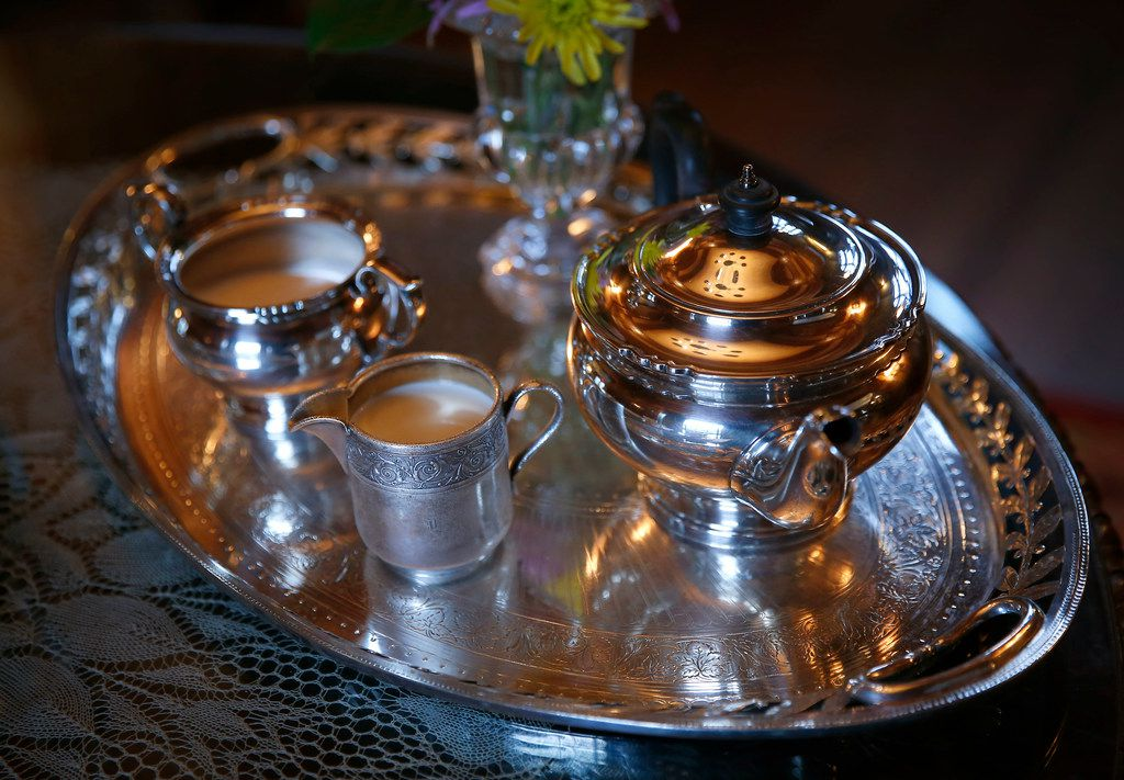 A silver tea service with sugar, creamer and teapot on silver tray at Aldredge House