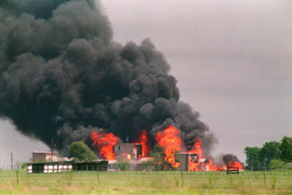 Fire engulfs the compound on April 19, 1993, after federal agents inserted tear gas into the building in an attempt to end the 51-day-old standoff and the Branch Davidians responded by setting the blaze.