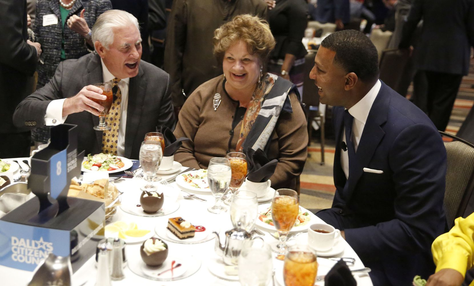Rex Tillerson (left), former U.S. secretary of state and former chairman and CEO of Exxon Mobil, laughed with his wife, Renda St. Claire, and Fred Perpall before the Dallas Citizens Council meeting at the Hyatt Regency Hotel in December 2018.
