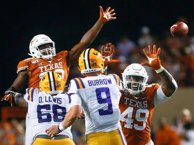Texas Longhorns linebacker Jeffrey McCulloch (23) and defensive lineman Ta'Quon Graham (49) attempt to block a pass by LSU Tigers quarterback Joe Burrow (9) during the fourth quarter of LSU's 45-38 win over the Longhorns on Saturday, Sept. 7, 2019 at Darrell K Royal- Texas Memorial Stadium in Austin, Texas. (Ryan Michalesko/The Dallas Morning News)