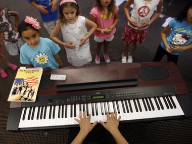 Allison Lanners (left) and Emilea Wuneburger sing at the Hockday School's summer camp from 2017.  A survey from Dallas-area education nonprofit Big Thought found that 57% of parents were still looking at summer camp options, despite COVID-19 concerns.