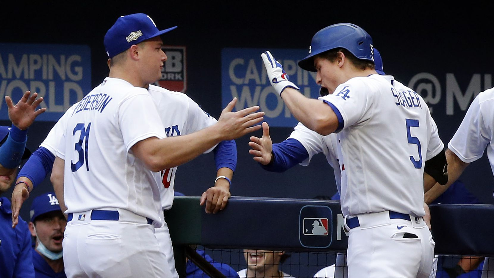 Los Angeles Dodgers shortstop Corey Seager (5)  is congratulated on his first inning solo home run by teammate Joc Pederson (31) in Game 6 of the National League Championship Series at Globe Life Field in Arlington, Saturday, October 17, 2020.