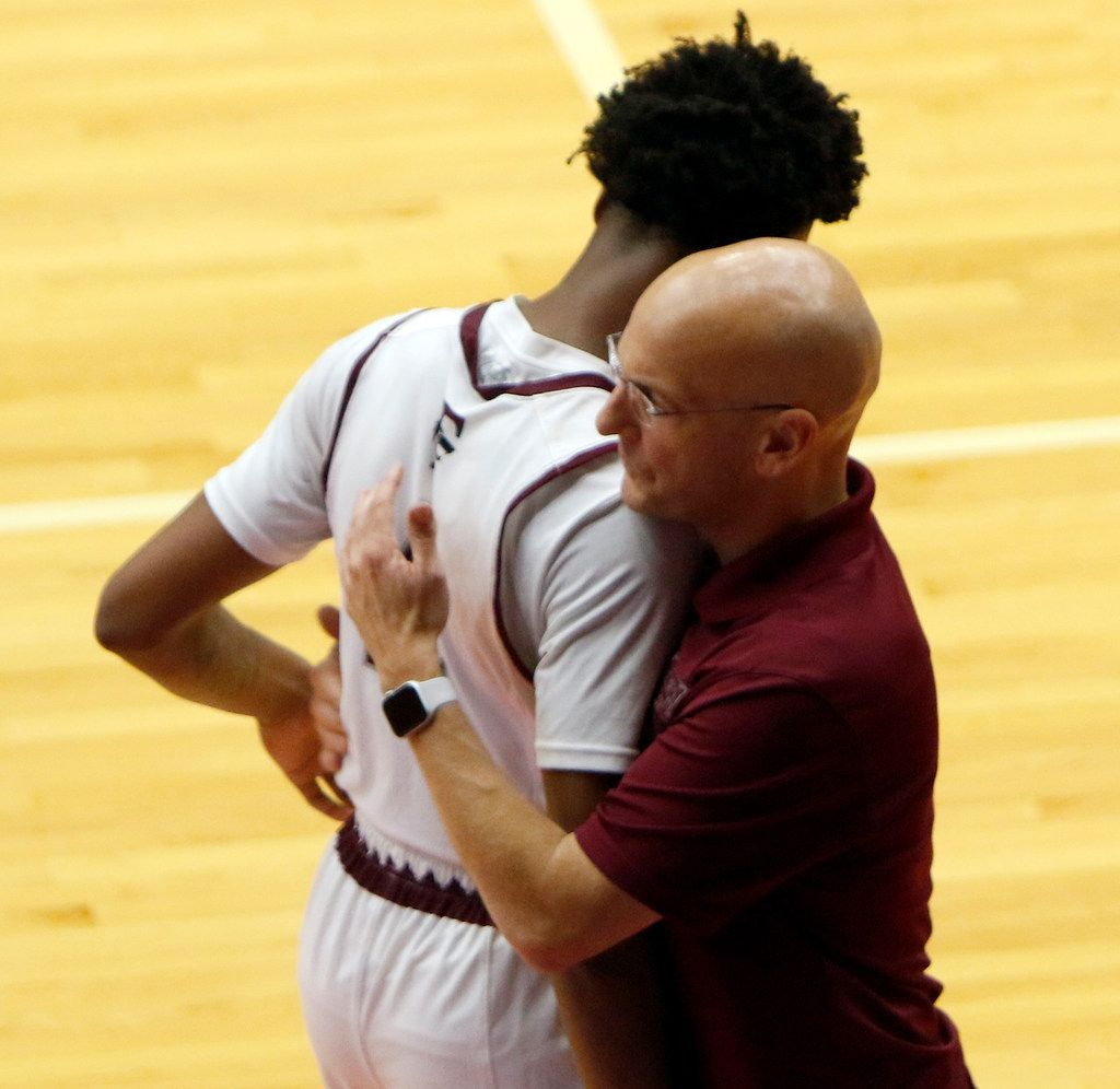 Mansfield Timberview head coach Duane Gregory shares a hug with Eyan Gooden (4) after the senior fouled out late in the 4th quarter of their game against Putnam City West, Okla. The two teams competed as part of the annual Thanksgiving Hoopfest basketball tournament held at the Sandra Meadows Arena on the campus of Duncanville High School in Duncanville on November 29, 2019. (Steve Hamm/ Special Contributor)