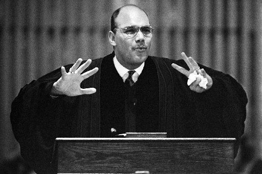 Rev. Dr. Derrick Harkins delivers  a sermon to the congregation at New Hope Baptist Church, where he  is the pastor, in 1993.